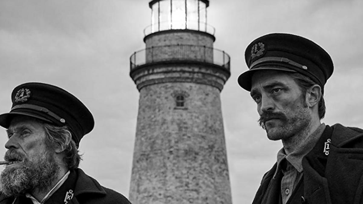 Wake (Willem Dafoe, left) and Winslow (Robert Pattinson) are lonely keepers of the flame in Robert Eggers' The Lighthouse.