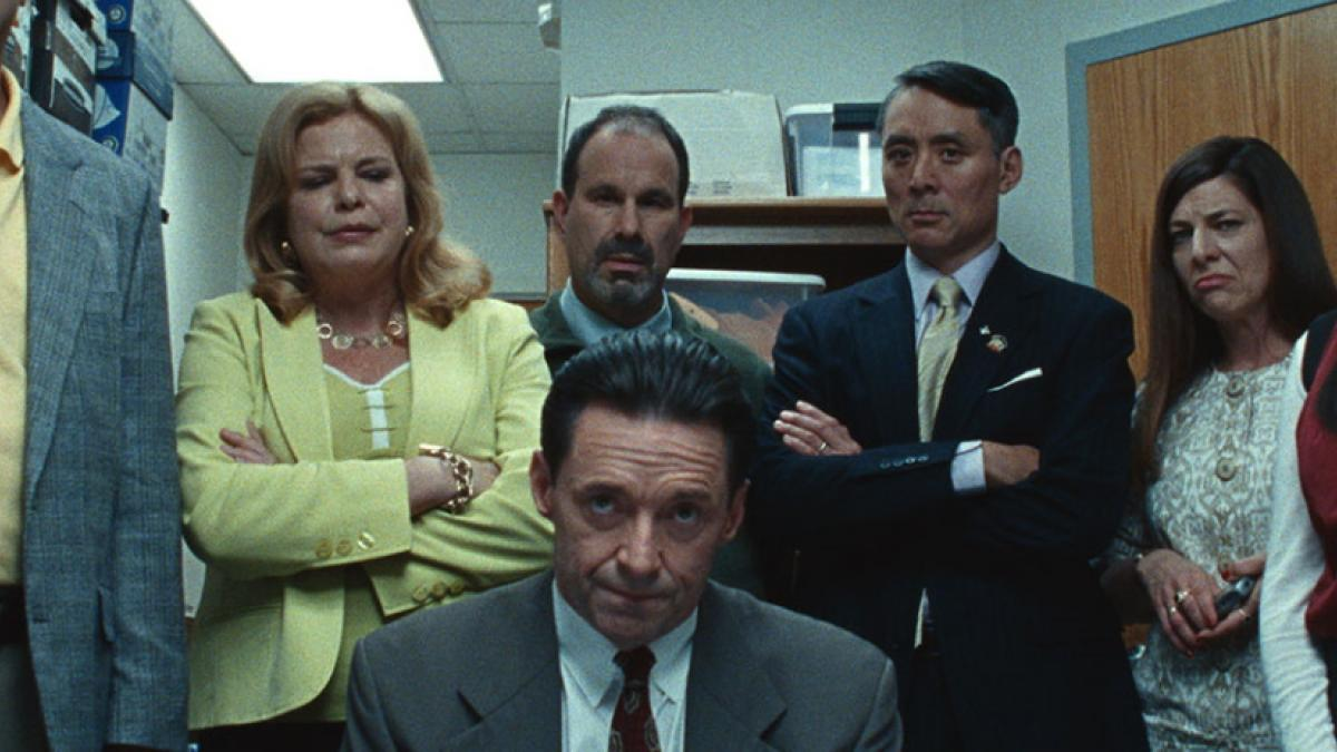 School superintendent Frank Tassone (Hugh Jackman, front center) comes under scrutiny in Cory Finley's 'Bad Education'.