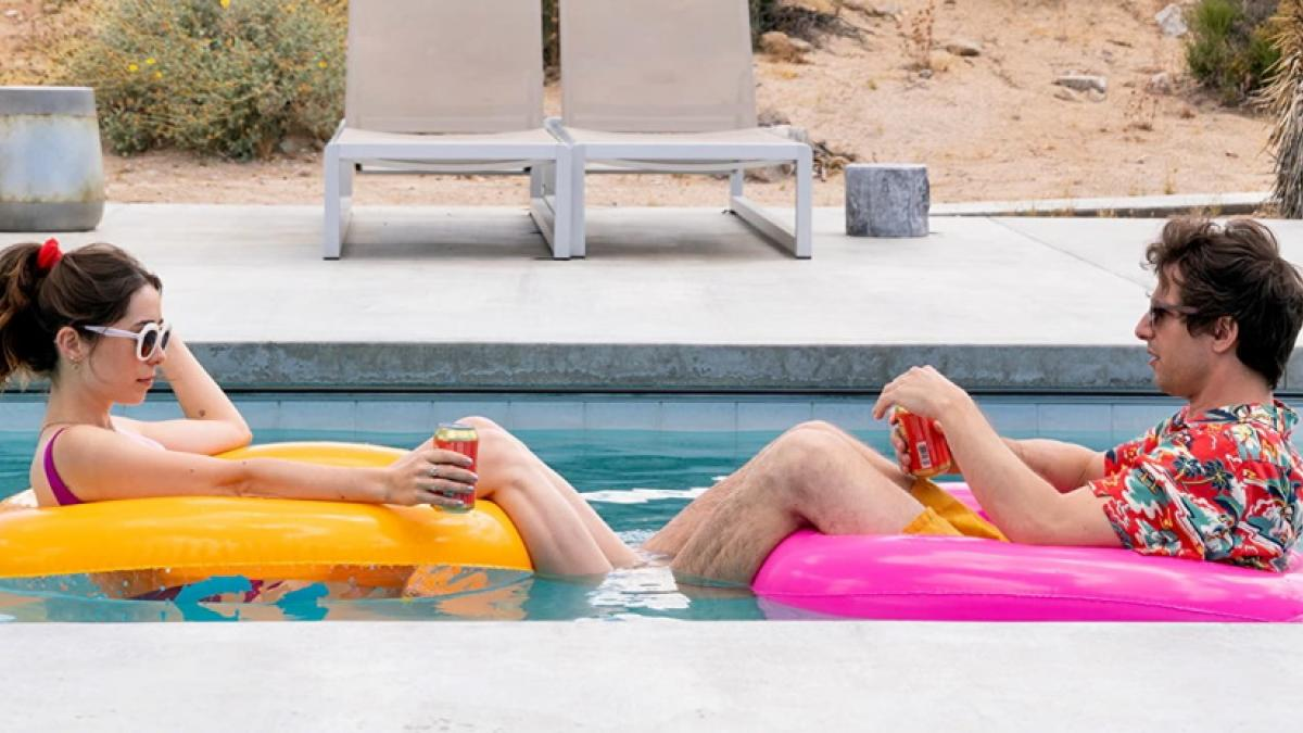 Christin Milioti (left) and Andy Samberg are a couple caught in destination wedding limbo in Max Barbakow's 'Palm Springs'.