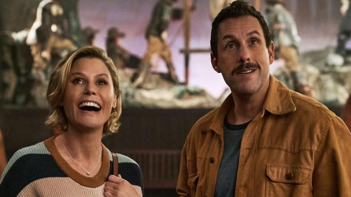 Julie Bowen (left) and Adam Sandler run afoul of a cruel, Halloween-obsessed town in Steven Brill's 'Hubie Halloween'.