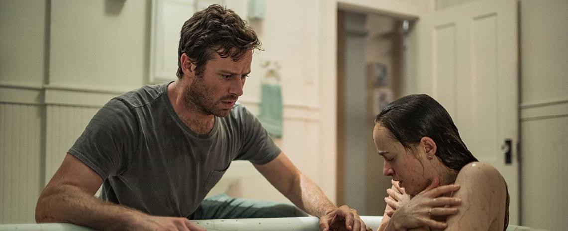 Will (Armie Hammer) and Carrie (Dakota Johnson) are plagued by dark visions in Babak Anvari's Wounds.