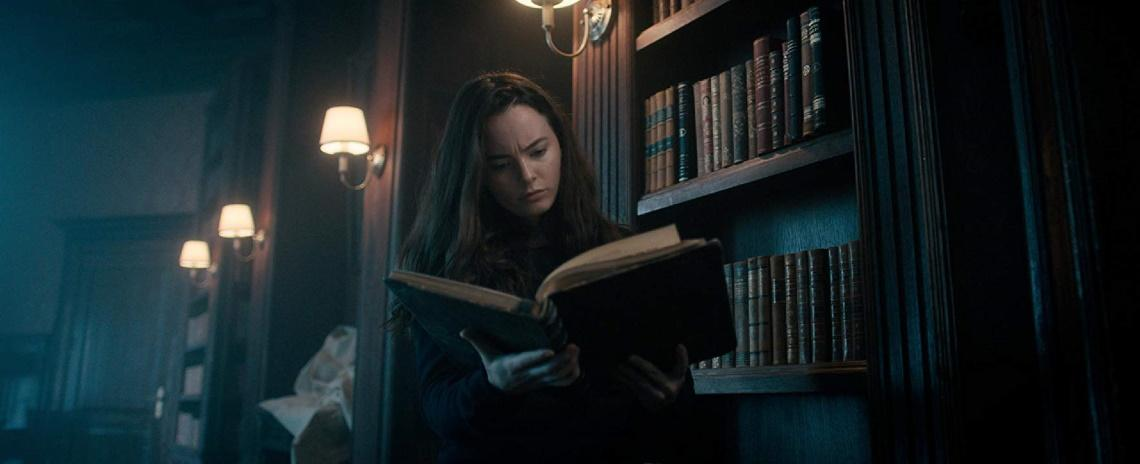 Violinist Rose Fisher (Freya Tingley) peruses one of her late father's books while searching for answers in Andrew Desmond's 'The Sonata'.
