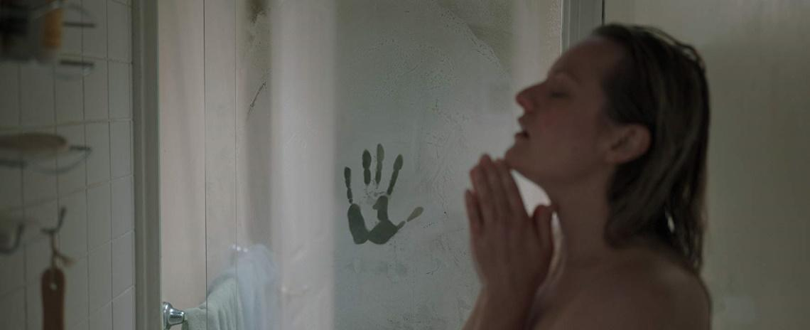 Cecilia Kass (Elizabeth Moss) showers, unaware of the ghostly handprint on the glass shower door, in Leigh Whannell's 'The Invisible Man'.
